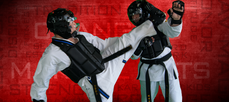 two men sparring with karate gear on