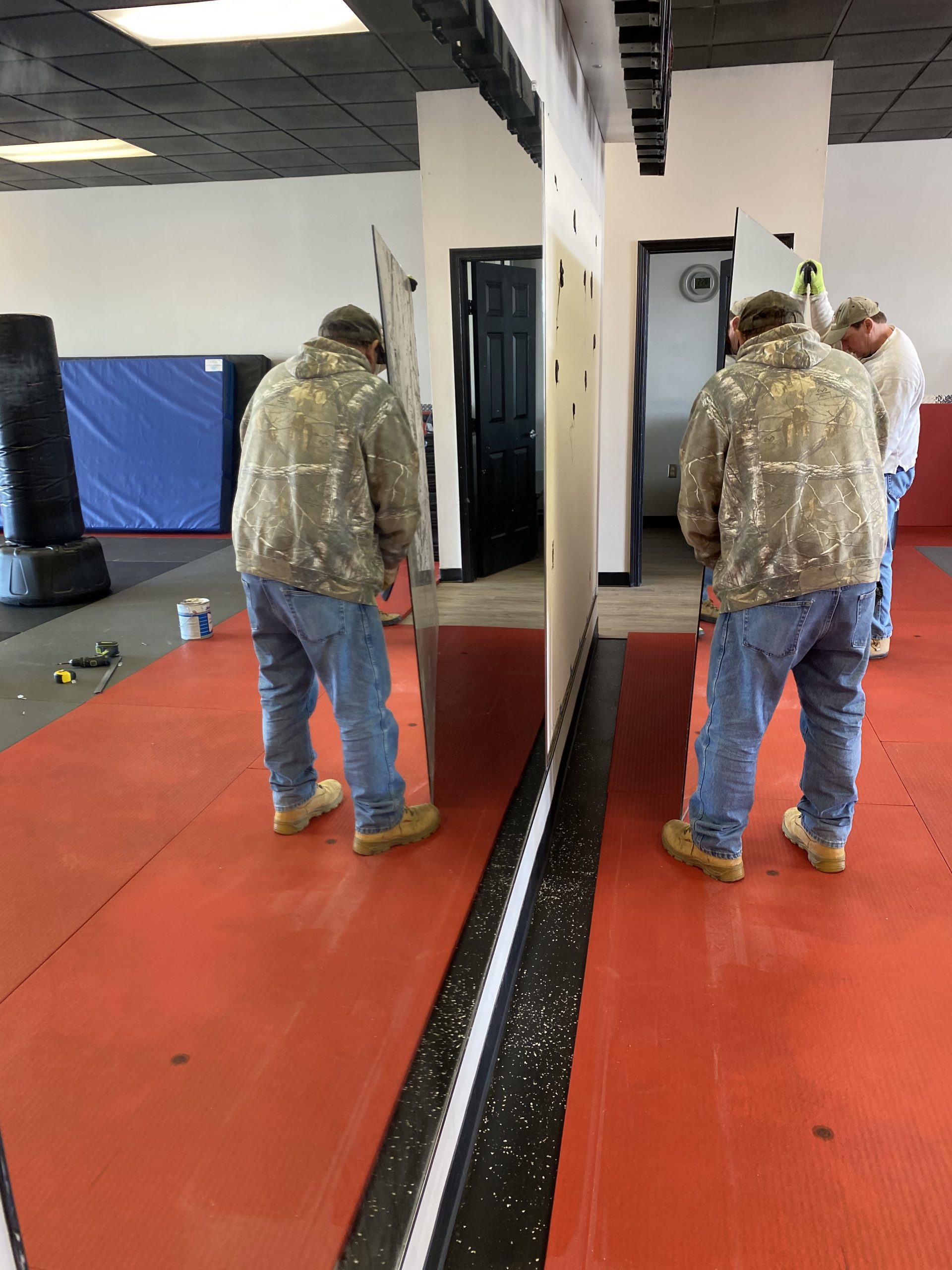 Men Removing Mirrors and GB Remodel